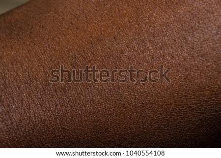 Human skin texture: Dark Brown African Skin texture #1040554108
