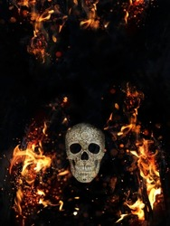human skull and fire flames on abstract black background. magical esoteric ritual. Mysticism, occultism, Witchcraft concept. Halloween background. copy space