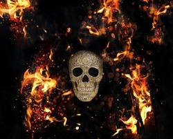 human skull and fire flames on abstract black background. magical esoteric ritual. Mysticism, occultism, Witchcraft concept. Halloween background.