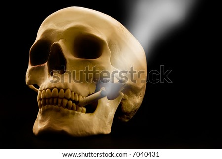 human skull over a black background with a smoking cigarette in the mouth - stock photo