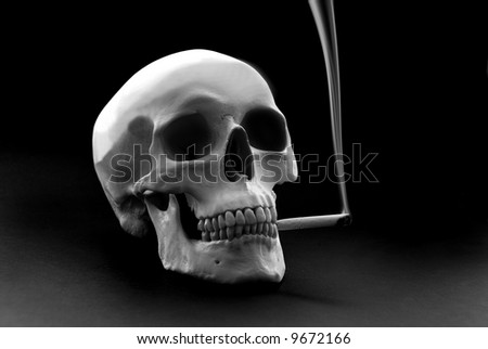 human skull over a black background with a smoking cigarette in the mouth