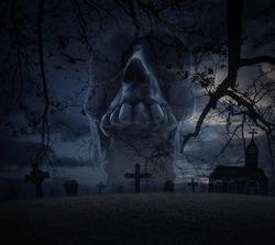 Human skull scream, grass, dead tree, cross, birds with church over spooky cloudy sky, Halloween concept