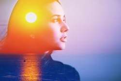 Human soul energy power spirit, inner peace, mental health therapy concept. Double exposure abstract art portrait of a happy woman head face side portrait look at sun sea nature sunrise sunset in sky