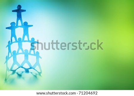 Human team pyramid on color background. Copy space.