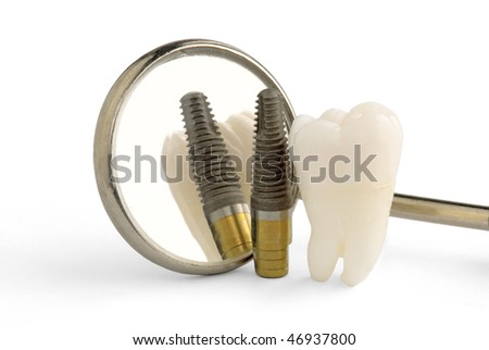 Human tooth, titanium implant and dental mirror