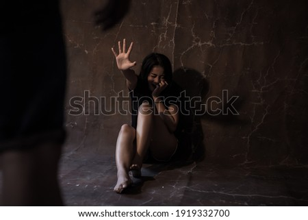 Human trafficking and Violence concept Bad guy rape asian woman and going to hit her Young girl get scared and begging him stop attack her Girl is always victim of violence She is crying and scream