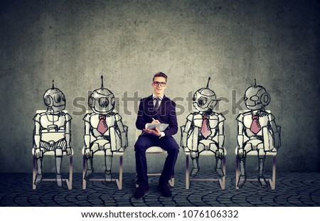 Human vs Robots concept. Business job applicant competing with artificial intelligence  #1076106332