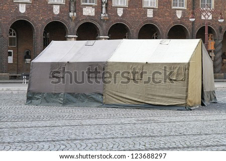 Humanitarian tent shelter after earthquake disaster in town #123688297