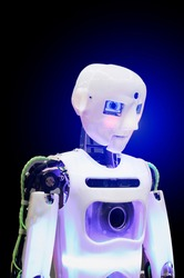 Humanoid robot on a dark background. Vertical photography.