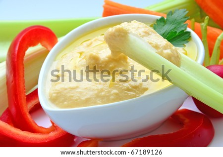 Hummus as a dip - stock photo