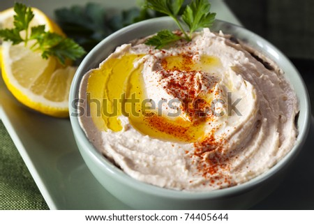 Hummus chickpea dip, with a little olive oil, paprika, and lemon.  Delicious healthy eating.