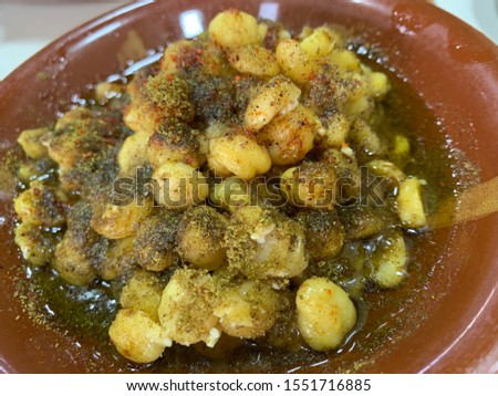 Hummus (Chickpeas) and Foul (Fava Beans), a traditional breakfast famous around the Middle East. enjoyed on the streets of the old souk, the breakfast is cheap yet very tasty