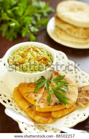 Hummus with herbs, paprika and olive oil