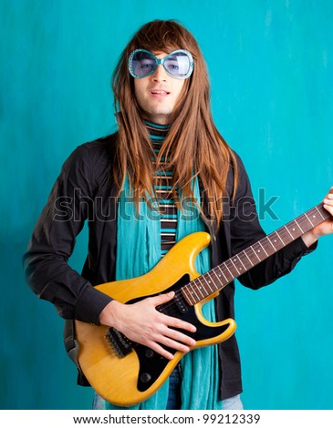 humor retro vintage hip heavy seventies guitar player with sunglasses - stock photo