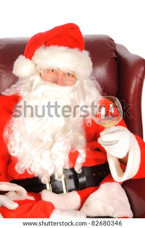 Humorous closeup of Santa Claus (that jolly old elf that  lives at the North Pole) enjoying a drink after a hard days work delivering christmas presents to the children