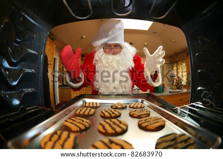 humorous image from within an oven of Santa in kitchen whipping up a batch of cookies,