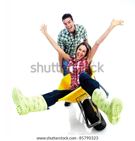 Humorous image of young happy couple. Isolated over white background.