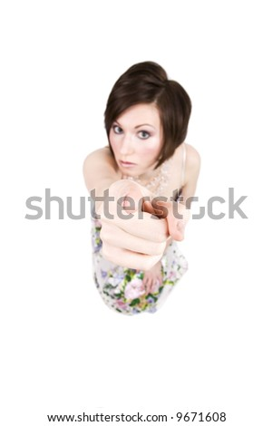 Humorous photo of an angry brunette woman through a fisheye lens pointing at camera. Focus is on tip of finger. Isolated on white.