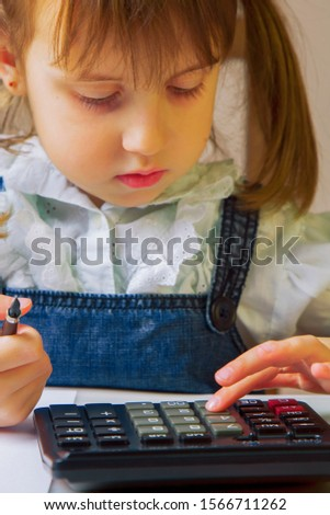 Humorous photo of young business girl calculate profit US Dollar banknotes with calculator.