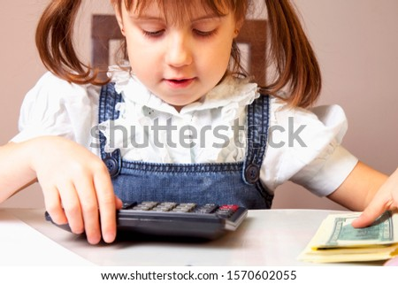 Humorous photo of young business girl making calculations. Savings, finances and economy.