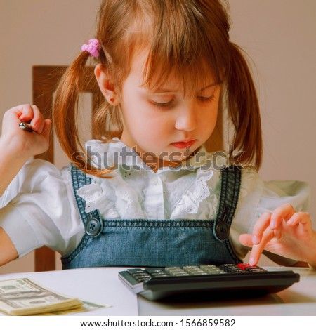 Humorous photo of young business girl making calculations. Savings, finances and economy concept.
