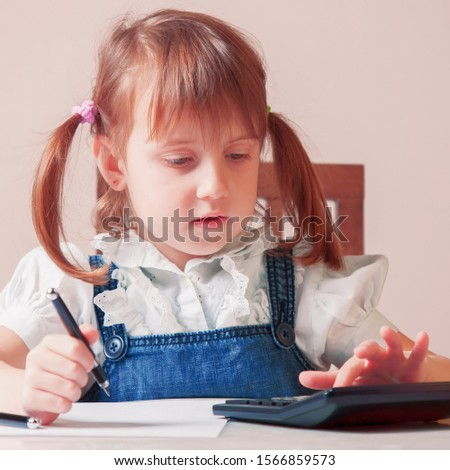 Humorous photo of young business girl  using calculator and calculate US Dollar bills in home office.