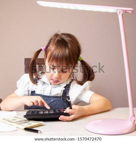 Humorous photo of young business girl  using the calculator and her make note calculate about cost at home.
