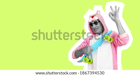 Humour. Senior man in funny suit like pink pantera isolated on green background. Collage in magazine style. Flyer with trendy colors. Copy space for ad. Fashion and style concept. Stock photo ©