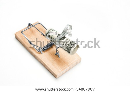 Hundred bucks in a mouse trap is isolated over white background