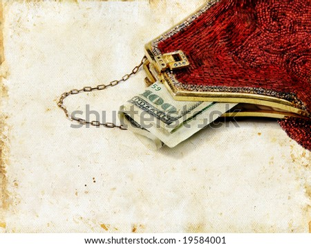 Hundred dollar bill sticking out of a red beaded purse. Grunge background.