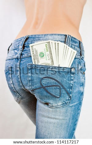 Hundred-dollar bills in the back pocket of jeans girl