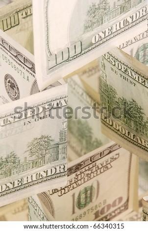 Hundred dollar bills money pile. Focus on center of a photo