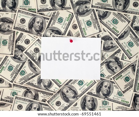 hundred dollar bills on background with note paper