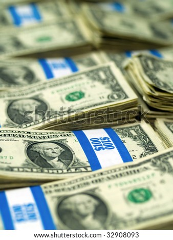 Hundred dollar bundles of U.S. One Dollar bill laid out as a background