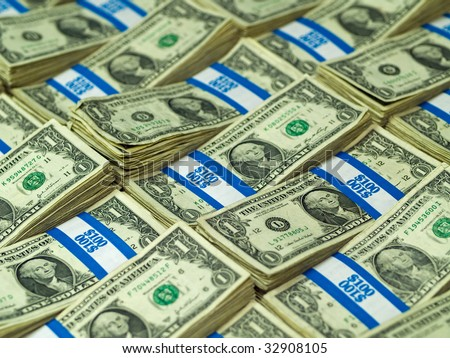 Hundred dollar bundles of U.S. One Dollar bill laid out as a background - stock photo