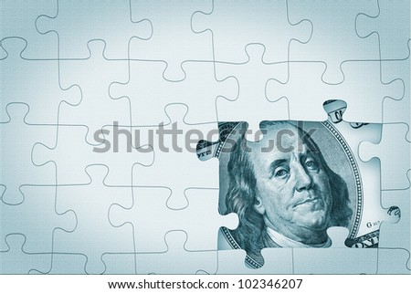 Hundred dollar under puzzle pieces extreme closeup