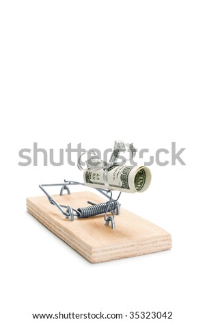 Hundred dollars bill in a mouse trap is isolated over white background