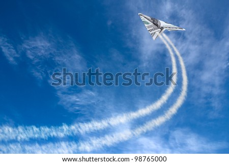 Hundred dollars plane on cloudy sky and trace .