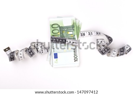 Hundred euro banknotes constraign with a measuring tape on white background with some shadows
