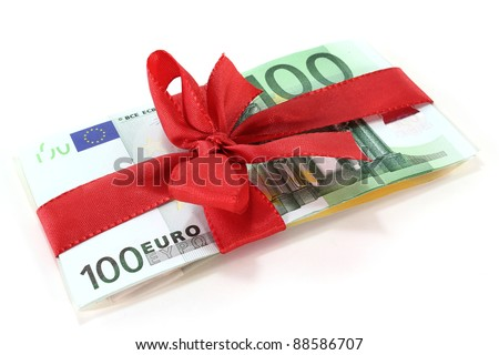 Hundred euro notes on a stack with red bow