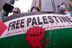 Hundreds of demonstrators holding flags and signs protest outside the Israeli Consulate to support the rights of Palestinians in their conflict with Israel, in Los Angeles, Calif., on May 11, 2021.