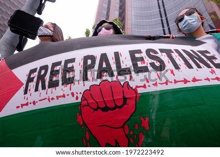 Hundreds of demonstrators holding flags and signs protest outside the Israeli Consulate to support the rights of Palestinians in their conflict with Israel, in Los Angeles, Calif., on May 11, 2021. Сток-фото ©