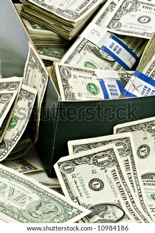 http://image.shutterstock.com/display_pic_with_logo/119401/119401,1207005660,3/stock-photo-hundreds-of-dollars-overflowing-old-cardboard-shoe-box-10984186.jpg