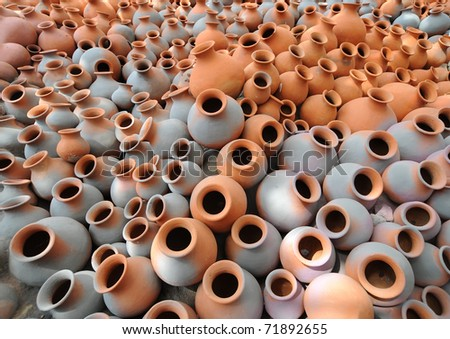 Hundreds of earthen water jars used in rural areas are stacked together