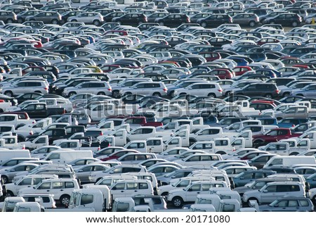 hundreds of new cars waiting for their owners