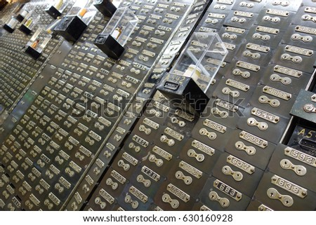 Hundreds of numbered lockboxes. skewed angle to emphasize disorienting number #630160928