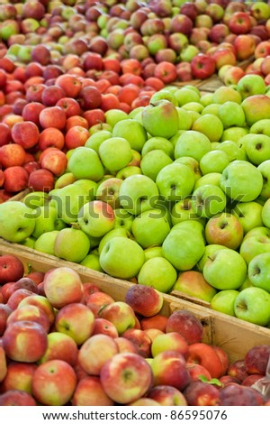 Hundreds of red, yellow and green apples in bins at a Michigan farm market in autumn.