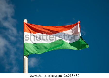 Hungarian flag against blue sky