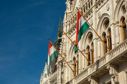 Hungarian flags on the Hungarian Parliament Building or Parliament of Budapest, a landmark and popular tourist destination in Budapest, Hungary
