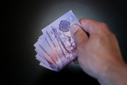 Hungarian forints cash in hand with black background
